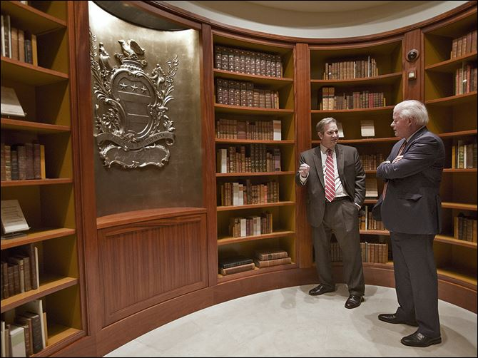 20n1bodes-1 Doug Bradburn, founding director of the Fred W. Smith National Library for the Study of George Washington, left, talks with Curt Viebranz, president and CEO of George Washington's Mount Vernon Estate, Museum, and Gardens, in the Rare Books Vault of the new library in Virginia.
