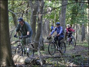Toledoan Aaron Brown leads other bikers during the Mountain Biking 102 event.