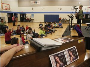 Crystal Bowersox performs in the school's gym.