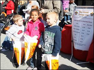 Devin Simpson-Maze, 3, left, Maleenah Clark, 6, and Kyle Simpson-Maze, 5. Devin and Kyle are siblings; the three are cousins.