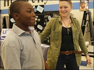 Jovon Toyer, 9, a fourth grader, tries to keep from smiling while talking with Crystal Bowersox, who signed autographs and sang at Reynolds Elementary School to support the school's health and wellness festival.