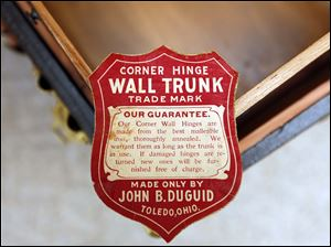 The label from a Toledo made wall trunk.