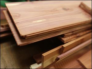 Cedar planks wait to be put into a trunk.