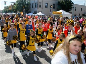 Northview High School junior cheerleaders in the parade.
