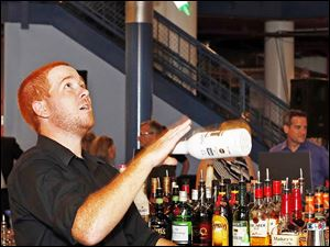 Bartender Brian Brubaker of Detroit juggles during The Bash .