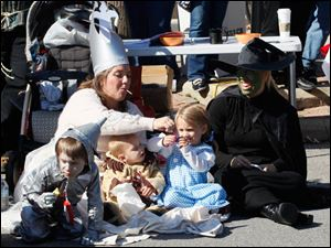 Children and adults donned costumes for the fall parade.