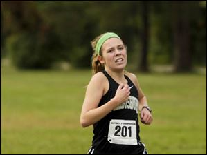 Perrysburg senior Taylor Monheim crosses the finish line to place first in Division I.