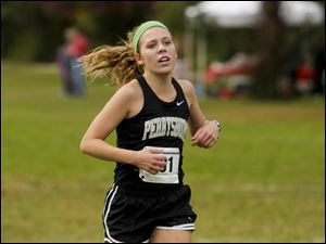 Perrysburg senior Taylor Monheim crosses the finish line to place first in Division I