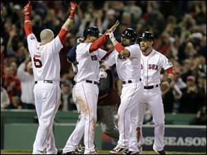Boston Red Sox's Shane Victorino, second from right, celebrates his grand slam with Jonny Gomes, left, Xander Bogaerts, second from left, and Jacoby Ellsbury, right, in the seventh inning during Game 6 of the American League baseball championship series against the Detroit Tigers on Saturday.
