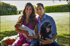 The Duke and Duchess of Cambridge pose in August  with their son in Bucklebury, England, and with  Tilly, left, a Middleton pet, and their cocker spaniel, Lupo.