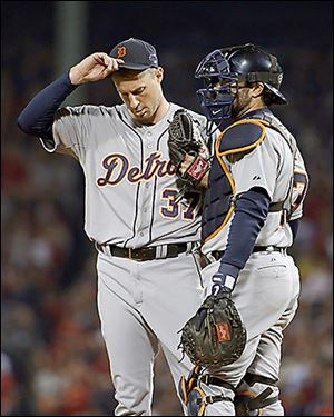 Tigers starting pitcher Max Scherzer, left, talks to catcher Alex Avila after walking Boston Red Sox's Dustin Pedroia in the sixth.