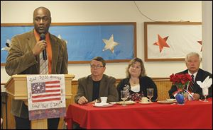 Aji Green, a candidate for the Toledo Board of Education, speaks at a candidates' breakfast on Saturday. Seated, from left, are Rob Ludeman, Chris Varwig, and James Nowak.