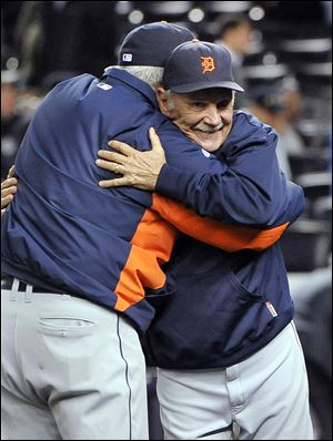 Jim Leyland, right, celebrates after his team beat the New York Yankees 3-2 in Game 5 to win a AL division series in 2011. The Tigers were in the playoffs four of his eight seasons.