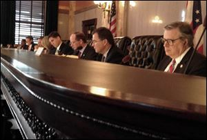 Members of Ohio Gov. John Kasich's cabinet are shown during a controlling board meeting.
