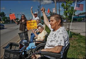 Demonstrations by residents of Navarre Avenue,  in summer 2011, protested safety hazards on the commercial corridor.