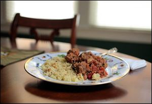 North African meatballs and couscous with dates.