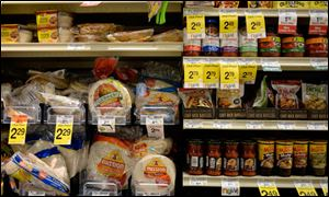 Tortillas and other items are seen in the International food aisle of a grocery store.