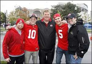Don Mewhort, center, father of Ohio State lineman Jack Mewhort, is flanked by his Canadian fishing guides, from left, Collin Reddekopp, Scott Tomkins, Nigel Daigneault, and Greg Sproat at Ohio Stadium. The guides traveled two days from Saskatoon.