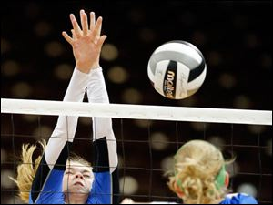 Anthony Wayne's McKenzie Gunner (10) hits the ball against St. Ursula's Elizabeth Coil (15).