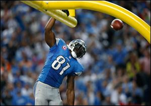 Detroit Lions wide receiver Calvin Johnson (81) celebrates his 50-yard touchdown reception against the Cincinnati Bengals in the fourth quarter of an NFL football game. 'Megatron' is one of the most exciting players in America's favorite billion-dollar football industry.