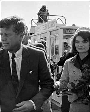 President John F. Kennedy and his wife, Jacqueline Kennedy, arrive at Love Field airport in Dallas, as a television camera, above, follows them.