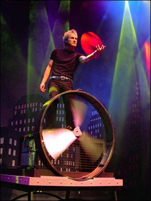 Illusionist Kevin Spencer says his show 'is a combination of my love of theater and love of magic.' He and his wife, Cindy, perform Sunday in Findlay.
