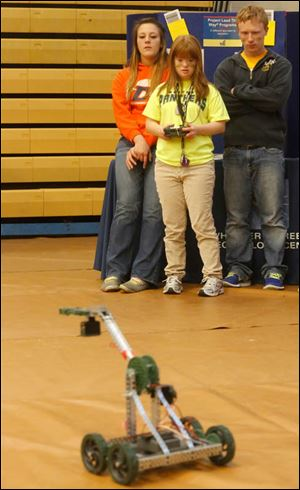 Bethany Wissler, 19, center, operates a robot constructed by members of Project Lead the Way, a pre-engineering program.
