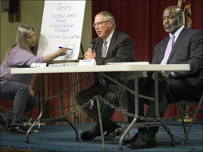 0001050100000000000 D. Michael Collins, center, and Mayor Mike Bell answer questions during ONE Village Council's mayoral candidate forum at the Chester Zablocki Senior Center.