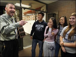 Principal Dave McMurray, left, congratulates some of the members of the mock trial team. From left: Eric Zhu, Catherine Dong, Lily Yan, and Claire Coder.