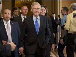 Senate Minority Leader Sen. Mitch McConnell walks to the Senate floor after agreeing to a deal to avoid default and reopen the government  last week.