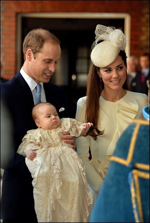 Britain's Prince William, Catherine, Duchess of Cambridge, with their son Prince George arrive at Chapel Royal in St James's Palace in London, for the christening of the three month-old prince.