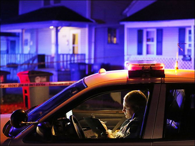 n5shot-1 Police on the scene where a Ms. Wells was shot at 658 Spring St. in North Toledo Wednesday.