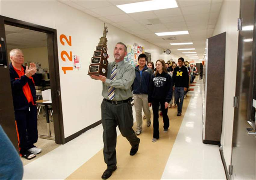 Principal-Dave-McMurray-center-holds-up-a-trop