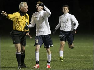 St. John's senior Adam Naayers (10) argues a with a referee.