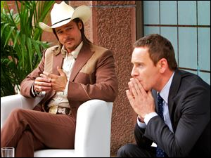 "This photo released by Twentieth Century Fox shows Brad Pitt, left, as Westray and Michael Fassbender as the Counselor, in the film, ""The Counselor."""