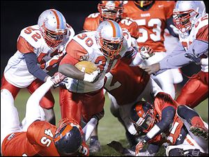 Bowsher's Mark Washington  ran 19 times for 219 yards and five touchdowns as the Rebels beat Rogers on Thursday night.