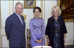 Myanmar opposition leader Aung San Suu Kyi , centre, stands with Britain's  Prince Charles Camilla  Duchess of Cornwall during a meeting Wednesday at Clarence House, in London.
