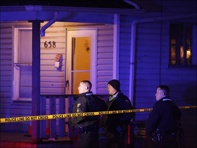 CTY shooting24p Police on the scene where a woman was shot at 658 Spring Street Wednesday in Toledo.