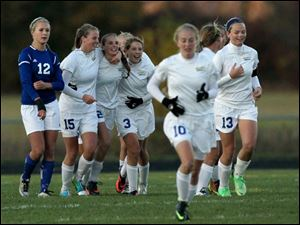 St. Ursula's players celebrate their goal against Anthony Wayne during the second half.