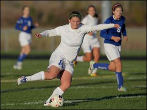 St. Ursula's Maddie Ladd (14) sends the ball flying down the field.