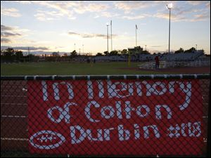 A sign hangs in memory of senior Colton Durbin.