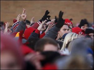 Members of the Bedford community, including many students, raised their hands up in a C with the number three in honor of senior defensive back Colton Durbin.