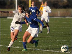 St. Ursula's Danielle Clear (12) and Anthony Wayne's Hannah Gyurasics (13) race for the ball during the first half.