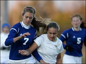 Anthony Wayne's Anna Glanz (7) and St. Ursula's Jordyn Greer (8) fight for control of the ball.