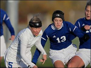 St. Ursula's Nicole Tye (5) and Anthony Wayne's Hannah Gyurasics (13) battle for control of the ball during the first half.