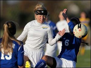 St. Ursula's Nicole Tye, center, battles Anthony Wayne's Chloe Brown (6) during the second half.