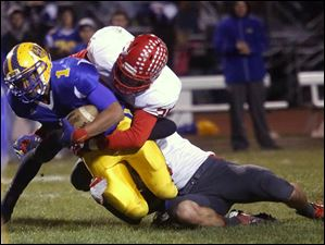 Monroe senior running back Elijah Sandore (1) is taken down in the first quarter.