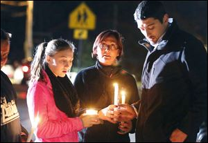 Parents and Danvers High School students hold candlelight vigil to mourn the death of Colleen Ritzer, a 24-year-old math teacher at Danvers High School Wednesday.