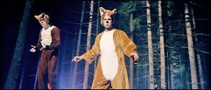 Funny brothers, Norwegian TV hosts, Bard, right and Vegard Ylvisaker, known as Ylvis, prance about in fox suits in their video, 'The Fox (What Does the Fox Say?).'