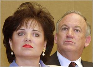 Patsy Ramsey and her husband, John, parents of JonBenet Ramsey, look on during a news conference in Atlanta in May, 2000.
